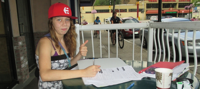 Young lady fills out application OTDC forms.